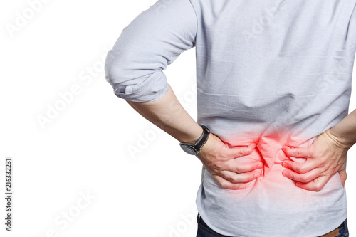 Cuadros en Lienzo  Man suffering from a lower back pain, isolated on white background
