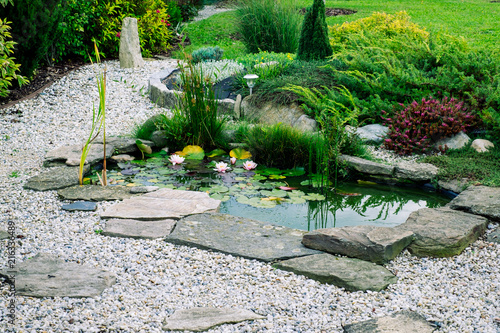 Canvas Prints Garden Garden architecture. garden pond. ornamental bushes.
