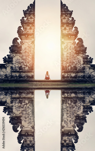Wall Murals Bali Woman sitting on the Gate of Temple , Bali, Indonesia. Calm, relax ,mind reset concept.