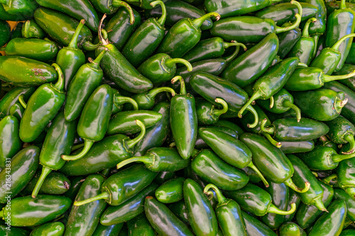 Poster Hot chili peppers Pile of Jalapeno peppers for sale