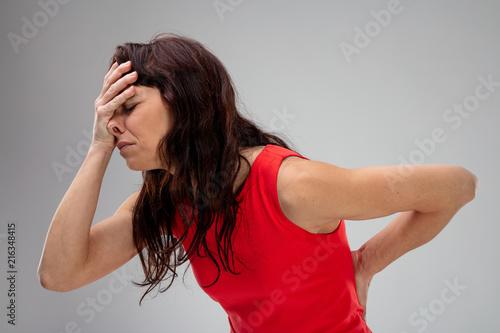Fotografía Miserable woman with backache