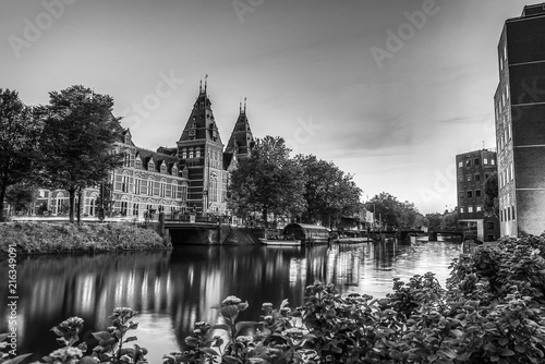 Foto op Plexiglas New York TAXI Сanals and embankments of Amsterdam city. Black-white photo.