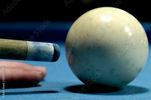 Fotografie, Obraz  Macro of the tip of a pool cue just before striking the cue ball on a pool table