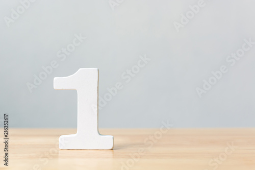 Obraz Number one wooden material on table. Concept top winner success with copy space - fototapety do salonu