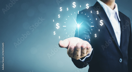 Businessman holding sign clock. Concept business time is money Fototapete