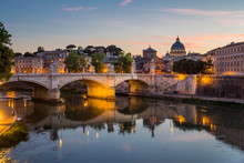 View Of St Peter's Cathedral And The Tiber River From Pont Sant'Angelo At Dusk