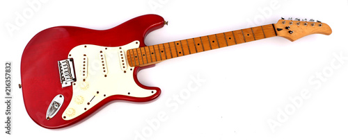 Fotografia, Obraz Red electric guitar with white backdrop.
