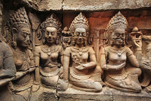 Three Women Sculptures At A Temple At Angkor Wat, Detail Of Carvings UNESCO World Heritage, Cambodia.