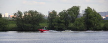 Red Towing Boat Rides Water Sk...