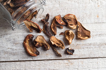Dried Mushrooms On The Wooden Table