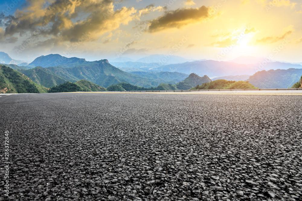 Fototapeta Empty asphalt road and mountain natural landscape at sunrise