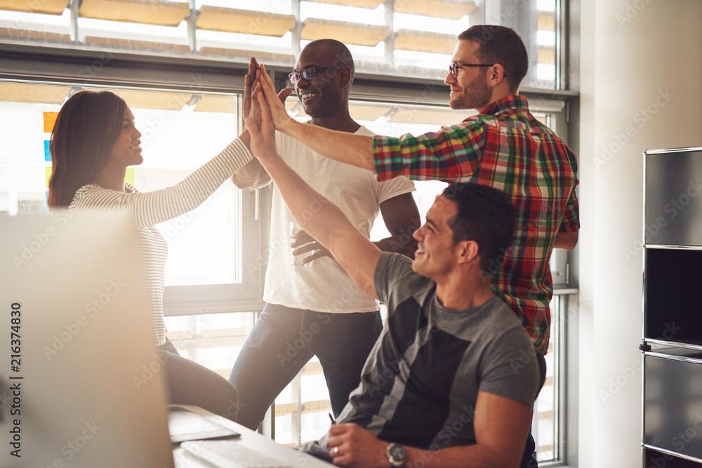 Fototapety, obrazy: Four adults celebrate an accomplishment
