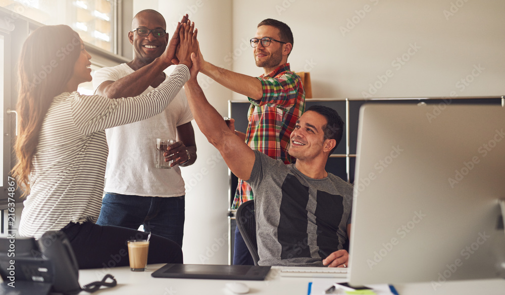 Fototapeta Diverse workers celebrating something in office