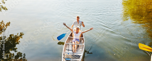Young woman enjoying the freedom of canoeing on a lake