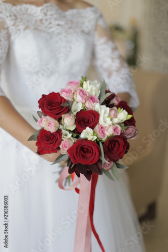 The Bride Is Holding A Bouquet Of The Bride From Large Red Roses