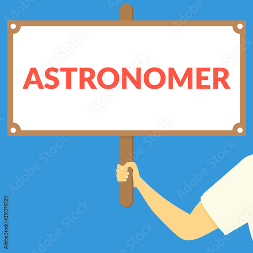 Photo ASTRONOMER. Hand holding wooden sign
