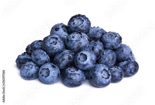 Group of fresh blueberries with leaves isolated on white background