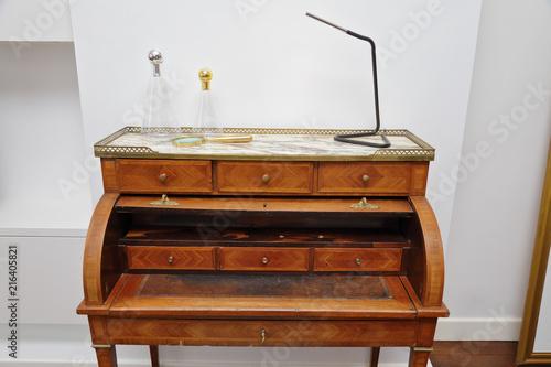 Bureau secrétaire en bois ancien buy this stock photo and