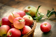 Organic apples in wicker basket on table - healthy eating in you diet