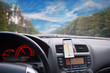 View from inside a car on dashboard with smartphone. mobile phone with gps navigation fixed in the mounting. App map for travel.