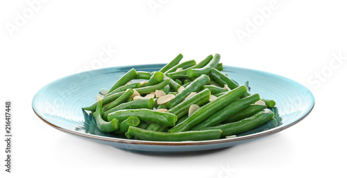 Plate with tasty green beans and almonds on white background