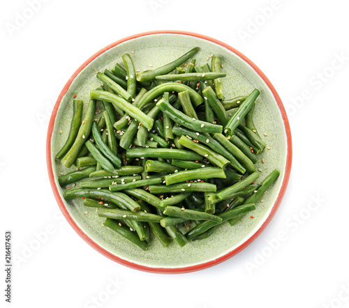 Plate with tasty green beans on white background
