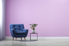 Stylish Comfortable Armchair Near Color Wall