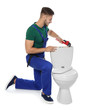 Young man working with toilet tank, isolated on white