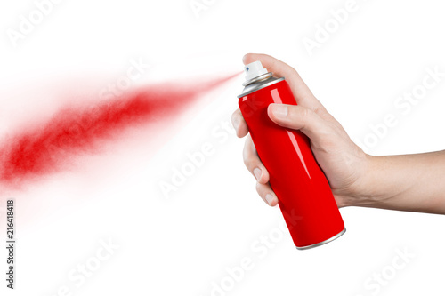 Photo Hand using red spray, isolated on black background