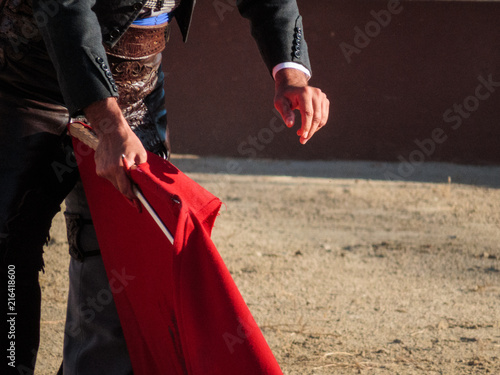 Bullfight - Matador holding sword and cape