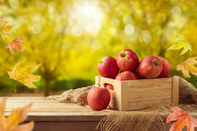 Red Apples In Wooden Box On Ta...
