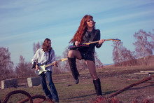 Guy With A Girl Playing Rock O...
