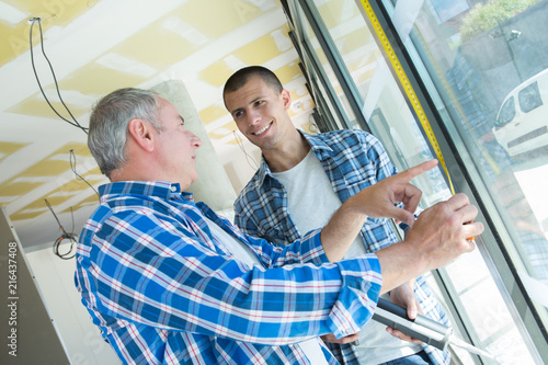 Fotografie, Obraz  two builders worker installing glass windows