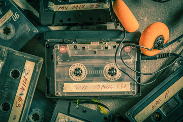Old audio cassette with headphones and walkman