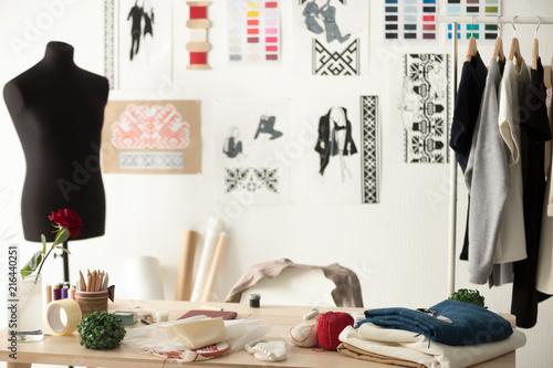 Creative fashion designer desk or workplace with sewing equipment, fabrics, temp Canvas Print