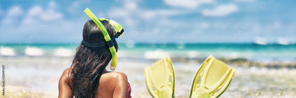 Fototapeta Snorkel girl with scuba mask and snorkeling fins relaxing on Caribbean beach travel summer vacation panoramic banner. Ocean watersport tropical fun.