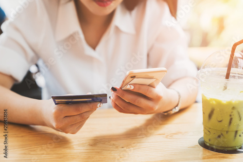 Fototapety, obrazy: Online payment or mobile internet banking concept - Woman hands holding using smartphones for shopping and credit card making order transaction