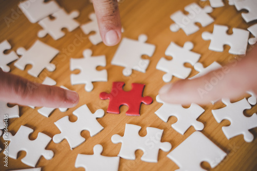 Fototapety, obrazy: Three hands pointing red pieces of jigsaw puzzle, business teamwork concept.