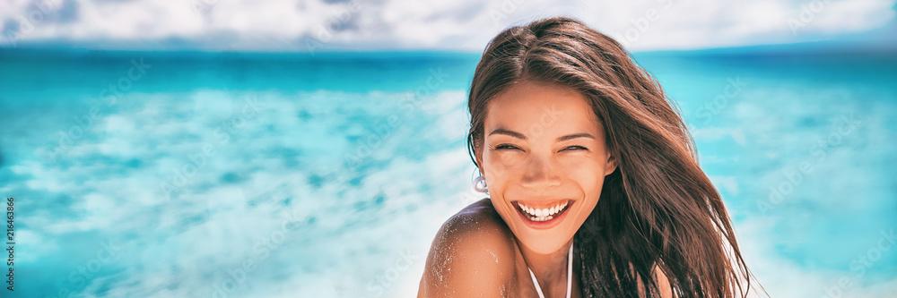 Fototapeta Beautiful Asian woman smiling relaxing on summer beach sunbathing banner panorama.