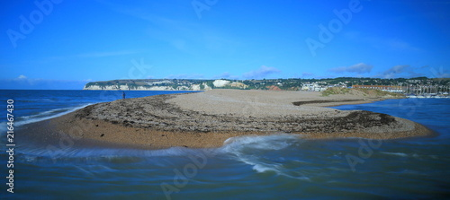 Pebble beach with blurred waves near town of Seaton in Devon on the Jurassic Coa Canvas Print
