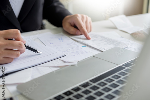 Photo business woman accountant or banker making calculations Bills