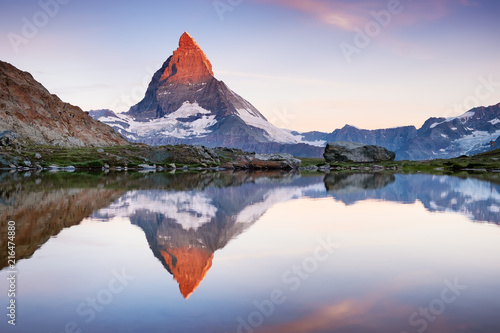 Foto auf AluDibond Gebirge Matterhorn and reflection on the water surface during sunrise. Beautiful natural landscape in the Switzerland
