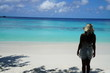 woman standing along the beach in the Maldives