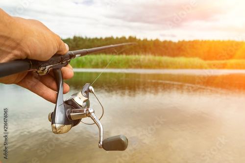 Spinning in the male hand, the river, sport fishing predatory fish.