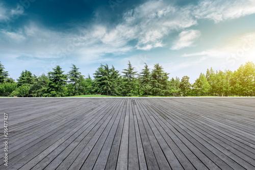 Papiers peints Jardin Wood square floor and green trees natural landscape
