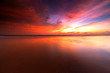sunrise Seascape with beautiful reflection for background. soft focus due to long expose.