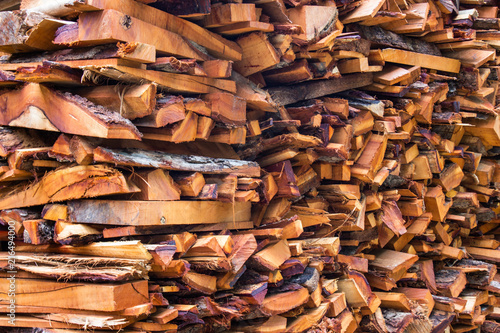Foto op Aluminium Brandhout textuur Firewood wooden logs big chopped trunks stacked pile dry for used fireplace in winter.
