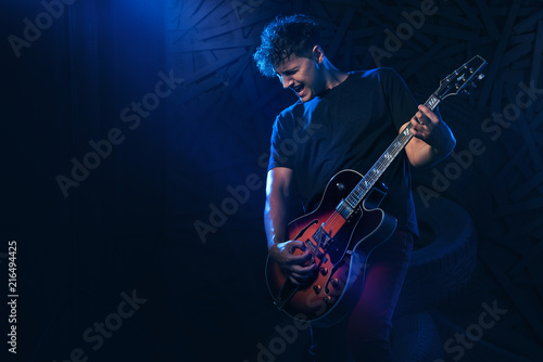 Fotografie, Obraz Rock band performs on stage