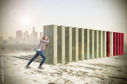 Fotografiet  Attractive woman pushing blocks