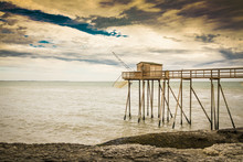 Wooden Fishing Hut On An Elevated Walkway